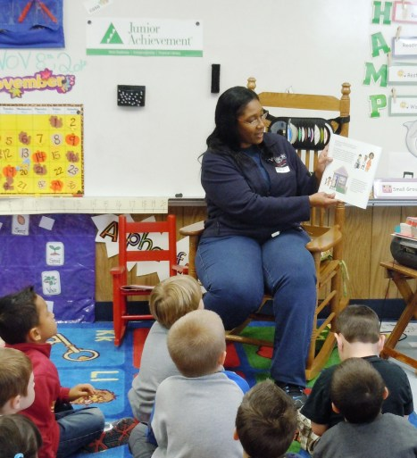 Alicia Mobley, Distributing Operator, reads a story to kindergartners about working hard to earn your reward.