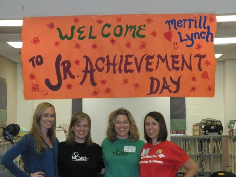 "Amy, third from left, with fellow Merrill Lynch colleagues during ""JA in a Day"" at Kings Trail Elementary."