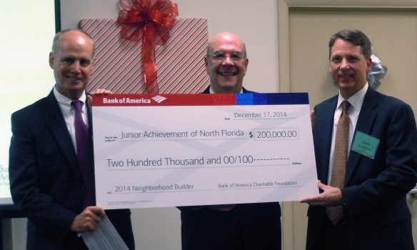 From left, Greg Smith, president of the Northeast Florida region for Bank of America, JA North Florida President Steve St. Amand, and JA Board Chair Charlie Kauffman at the award ceremony on Dec. 17.
