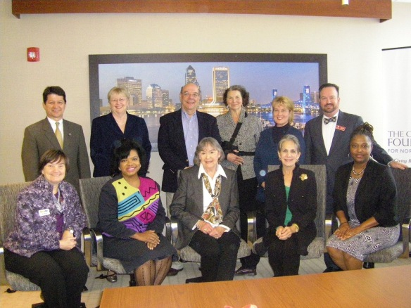 Delores Barr Weaver (front row, center) with representatives from the selected organizations including JA  of North Florida President, Steve St. Amand (back row, center).