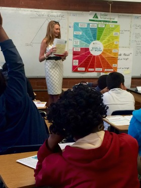 MassMutual volunteer Julie Chancellor teaching JA Economics for Success to seventh grade students at Jeff Davis Middle School.